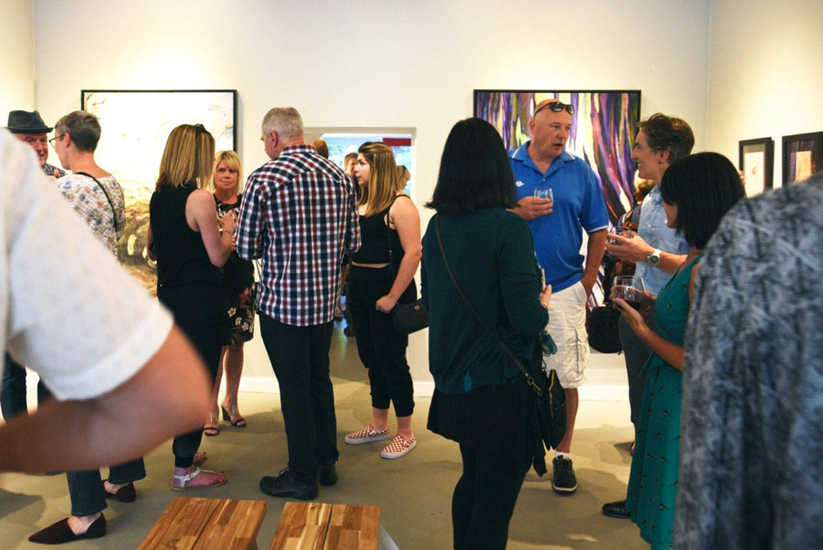 Art lovers filled the Fort Gallery for the Traces Juried reception on May 30th. (Margaret Campbell/Special to the Langley Advance Times)