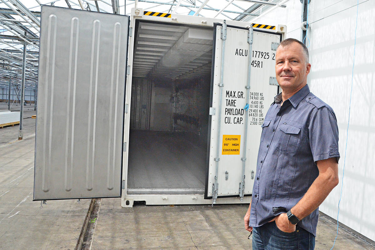 Leo Benne, chief growing officer of Zenabis, with the converted shipping container that will become a testbed for a vertical cannabis farm. (Matthew Claxton/Langley Advance Times)
