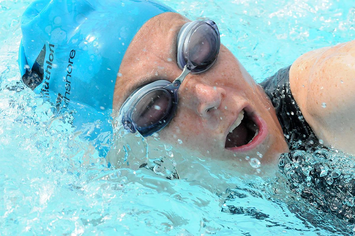 Sandra De Castillo powered through the pool at the start of the adult Tri-It triathlon. Dan Ferguson Langley Advance Times