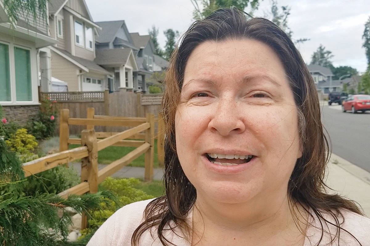 Lisa Ebenal said seeing her neighbours putting up pride flags lifted her spirits after her flag was temporarily removed by municipal workers because of a complaint. Dan Ferguson Langley Advance Times
