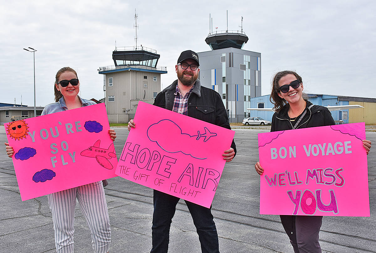 Friends and family came to see the pilots off at the Pitt Meadows Airport, and Liz Maruk, Max Lyon and Jasmine Ash-McQuillan made signs that could be seen from a great height. (Neil Corbett/THE NEWS)