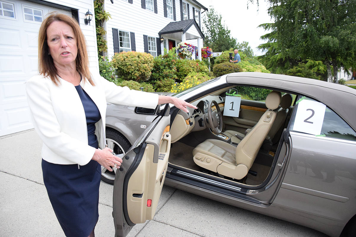 Crime Stoppers executive director Linda Annis points out two security errors in this parked car: an open window, and a purse left on the passenger seat. (Samantha Anderson)