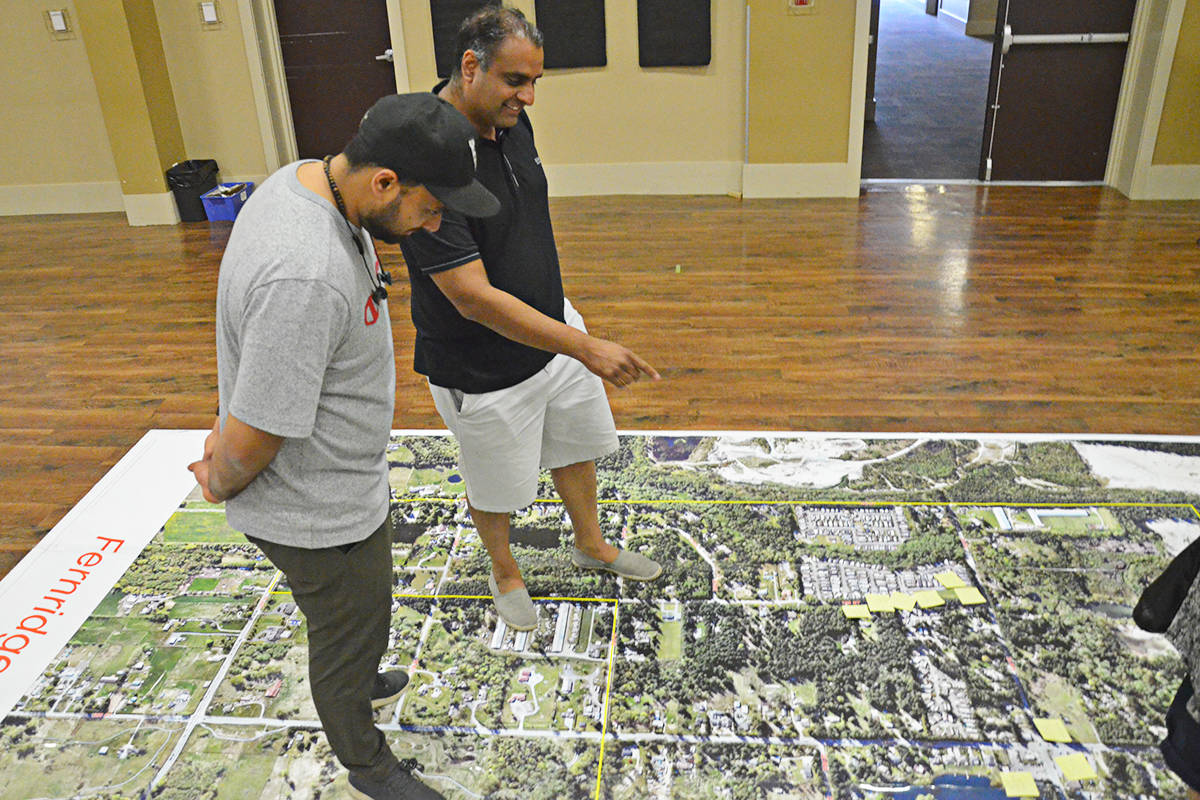 Ajit Gill (left) and Victer Aujla checked out one of the big floor maps showing three of South Brookswood's neighbourhoods on Tuesday. (Matthew Claxton/Langley Advance Times)