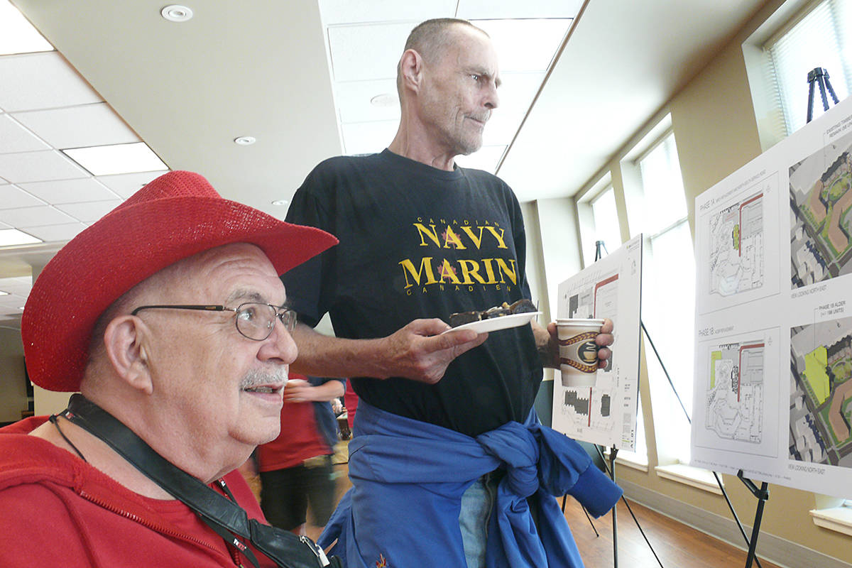 Former Birch residents Ed Thomas and Arthur Gauthier inspect the drawings for the new building. Dan Ferguson Langley Advance Times