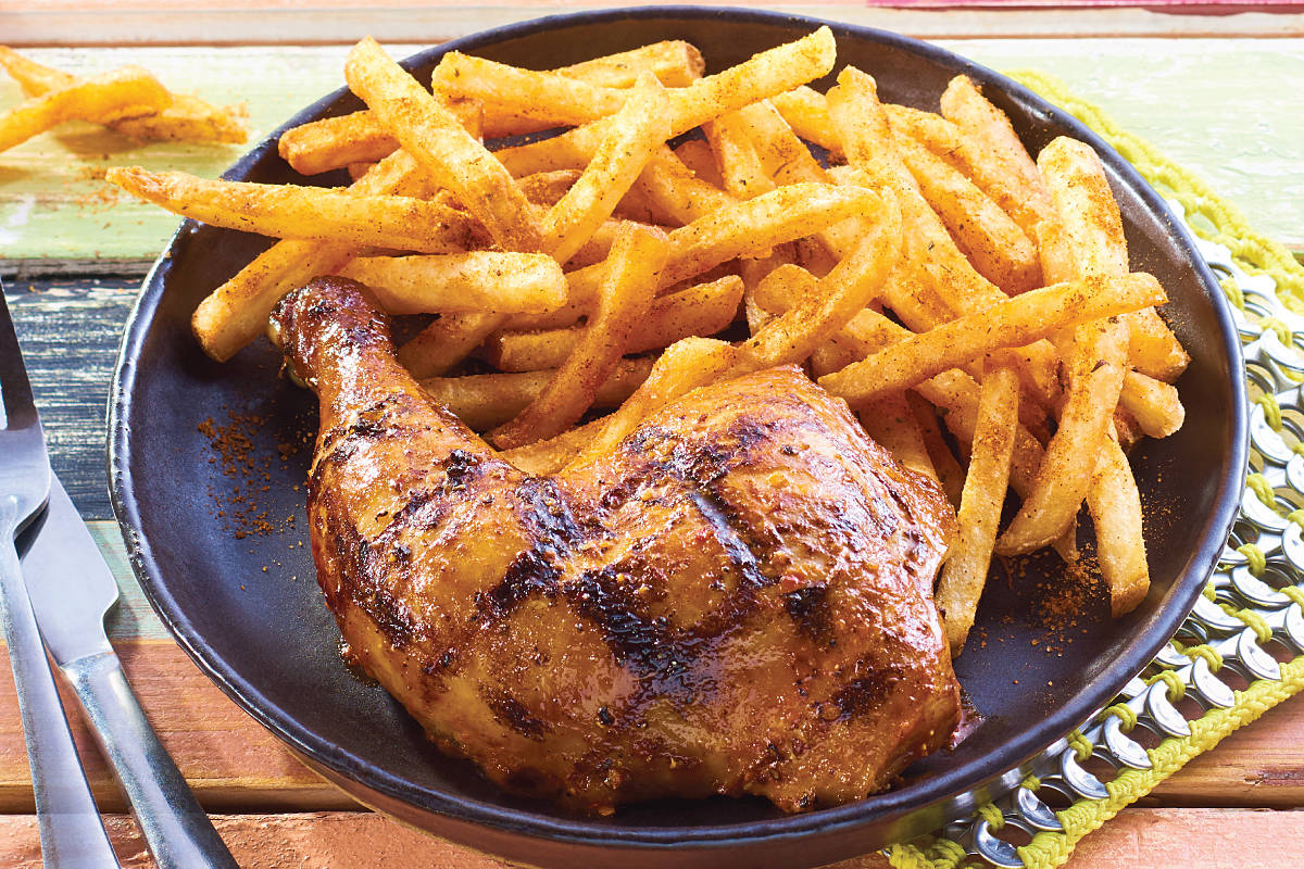 Flame-grilled 1/4 chicken with PERi-PERi fries are yours Sunday, if you bring a non-perishable food donation to the local Nando's restaurant between 11 a.m. and 1 p.m. (Special to the Langley Advance Times)