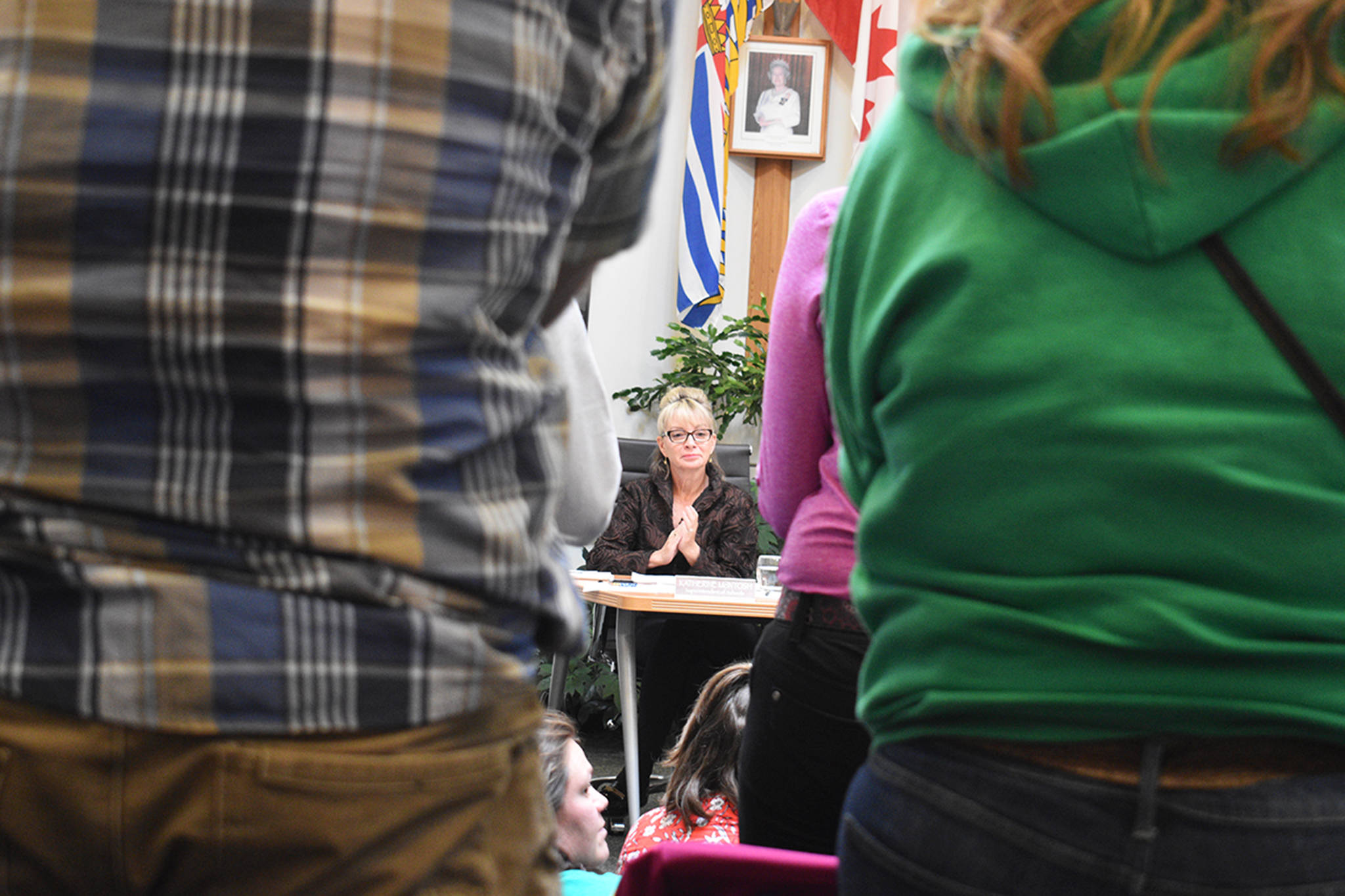 Parents and community members stand and applaud after an emotional plea for the district to not reassign three popular administrators as superintendent Katherine McIntosh looks on at the crowd on June 19. (Brittany Gervais/Terrace Standard)