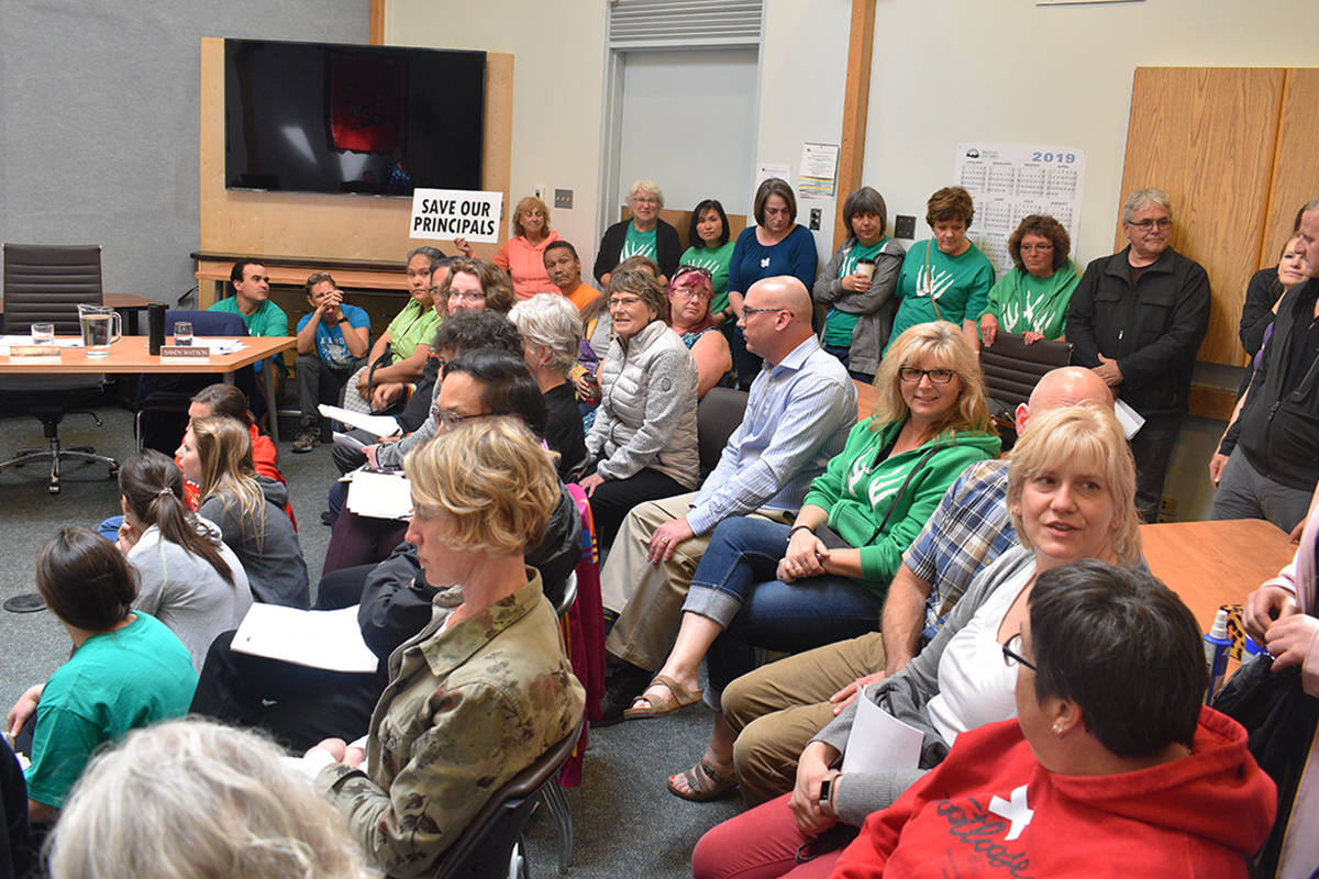 More than 70 teachers, parents, students and officials flooded the school board office on Wednesday, June 20. High turnout forced many to stand or sit on the floor and tables. (Brittany Gervais/Terrace Standard)