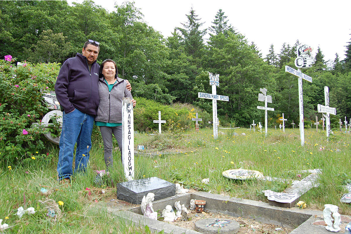 Campbell River residents Dean and Denise Nelson are pictured at the grave of Doreen Joseph, Denise's daughter, in Alert Bay on June 9. Photo by David Gordon Koch/Campbell River Mirror