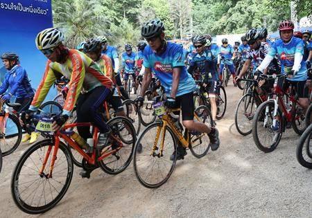 Participants start a marathon and biking event in Mae Sai, Chiang Rai province, Thailand, Sunday, June 23, 2019. (AP Photo/Sakchai Lalit)