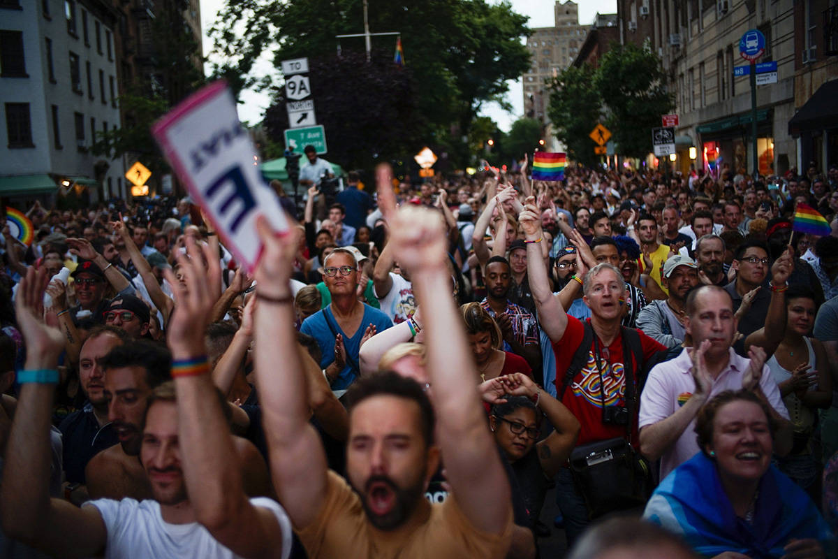 People attend the Stonewall 50 Pride Rally, Friday, June 28, 2019, in New York. Thousands of people have converged on New York City's Stonewall Inn for the 50th anniversary of the rebellion that catalyzed a movement for LGBTQ liberation. (AP Photo/Eduardo Munoz Alvarez)