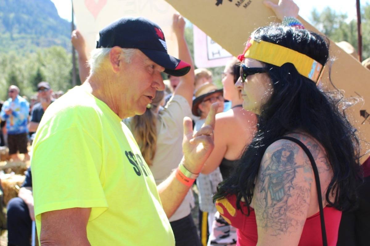 A security guard at the event speaks to one of the protesters at the Mighty Men's Conference in Castlegar on Sunday, June 30, 2019. (John Boivin/Castlegar News).