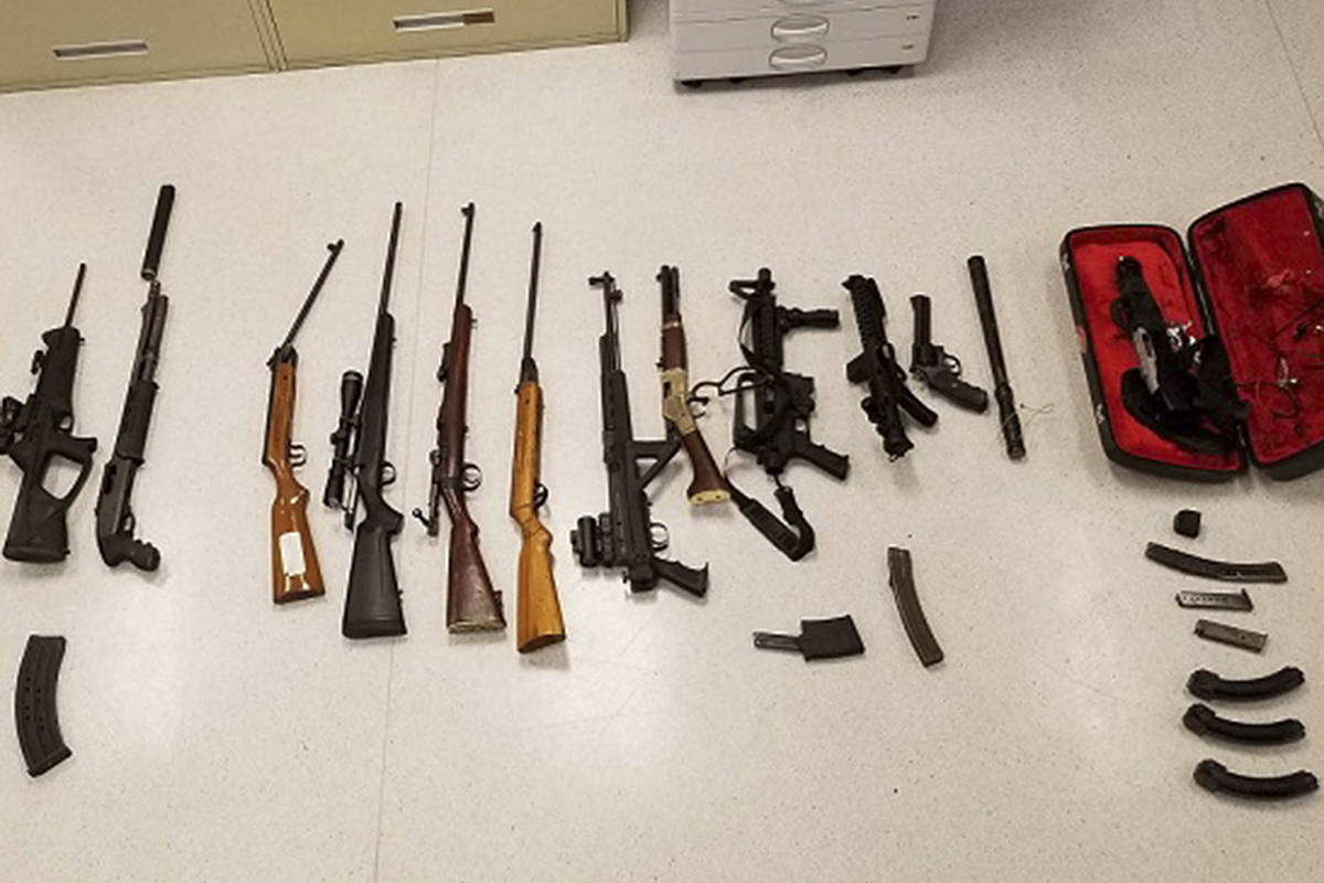 Chase RCMP seized a cache of weapons on June 21 near Scotch Creek in the North Shuswap, including several prohibited weapons. They included a Norinco Mak-90 fully automatic rifle, a Sterling Mark 4 Sub Machine gun, a Smith & Wesson revolver with a ground-off serial number and a drum magazine, and a suitcase gun. (Chase RCMP photo)