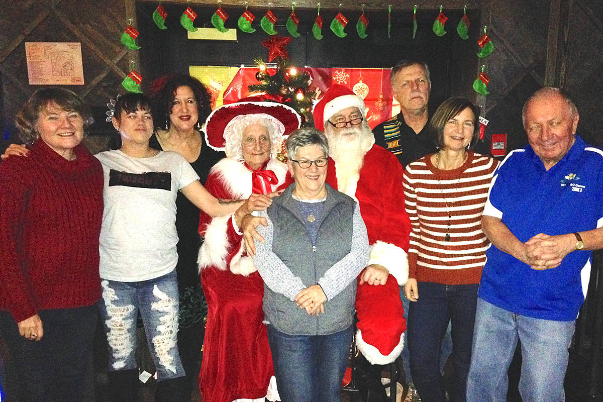 (Left to right) Susan Cairns, executive director of Langley School District Foundation; Kim; Rosemary Wallace, president Langley School District Foundation; Lynda McLean (Mrs. Claus); Linda Jensen, foundation director; Santa Claus; Frank Bucholtz; Grace Stewart, foundation director; and Don McLean. (Special to the Langley Advance Times)