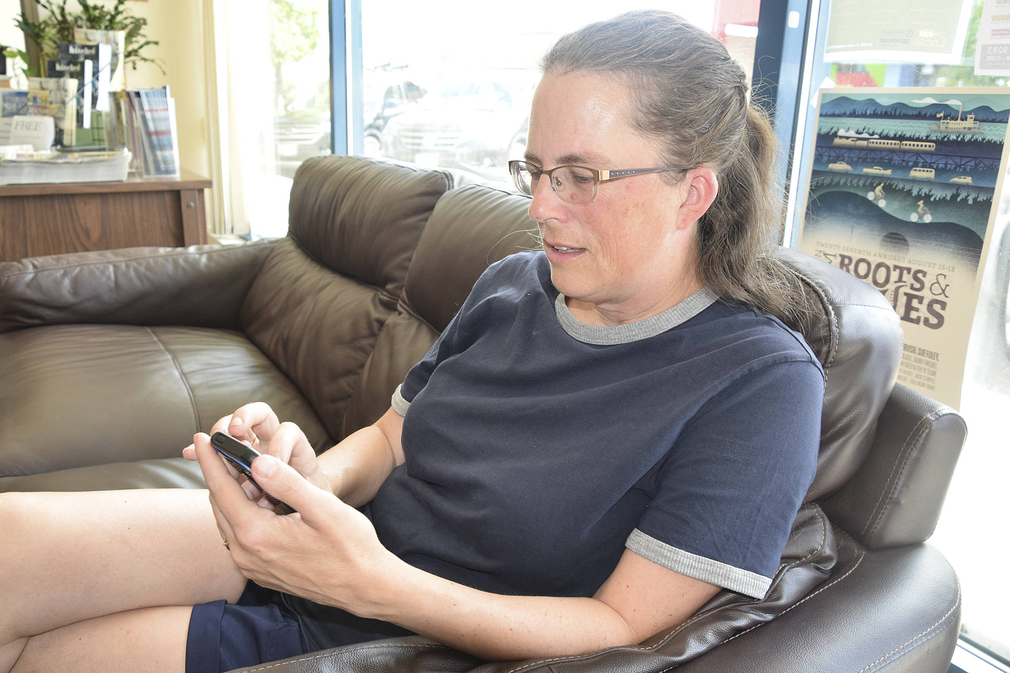 Salmon Arm's Wendy Goldman texts with her sister who lives in Ridgecrest, California, 17 kilometres from the epicentre of a 7.1 magnitude earthquake, where her neighbourhood was rocked by reportedly the largest quake the state has experienced in 20 years. (Martha Wickett/Salmon Arm Observer)