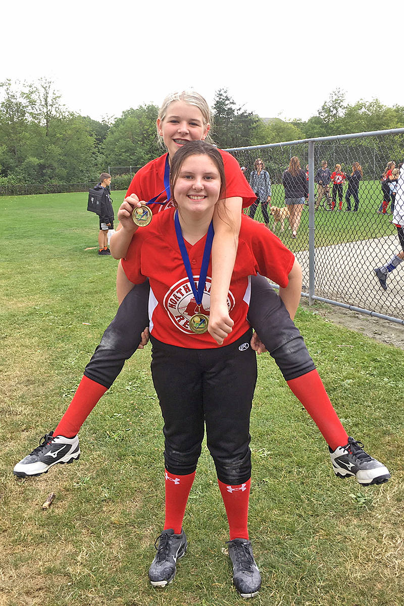North Langley U14C Red Sox players celebrate their gold medal win. Julia McGlynn gets a ride from Caitlyn Burkett. Sox beat Bandits 9-7. Contributed photo