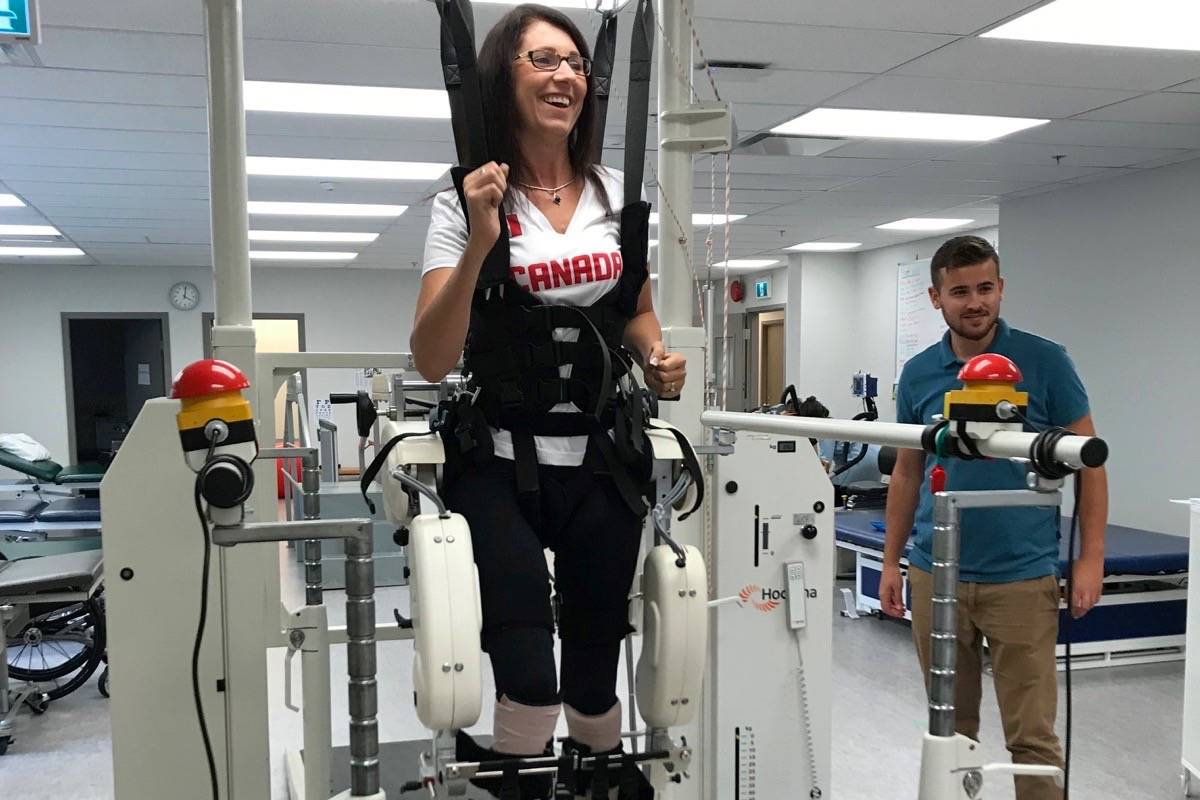 Michelle Stilwell, MLA for Parksville-Qualicum, uses the Lokomat machine at the Neuromotion Physio clinic in Victoria. - Submitted photo