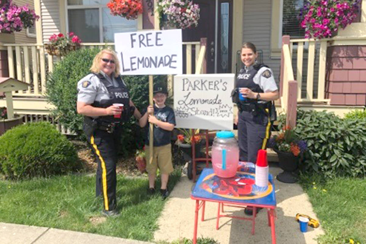 Cloverdale's Parker Holbeche-Boyer had some special customers at his free lemonade stand on Thursday, July 18, when Surrey RCMP members and firefighters came by for a glass. (Contributed)