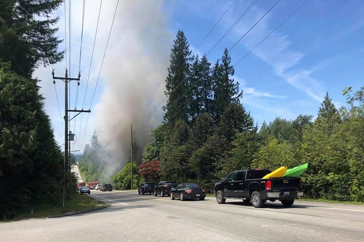 A fire has closed Dewdney Trunk Road in Maple Ridge. (Facebook photo)