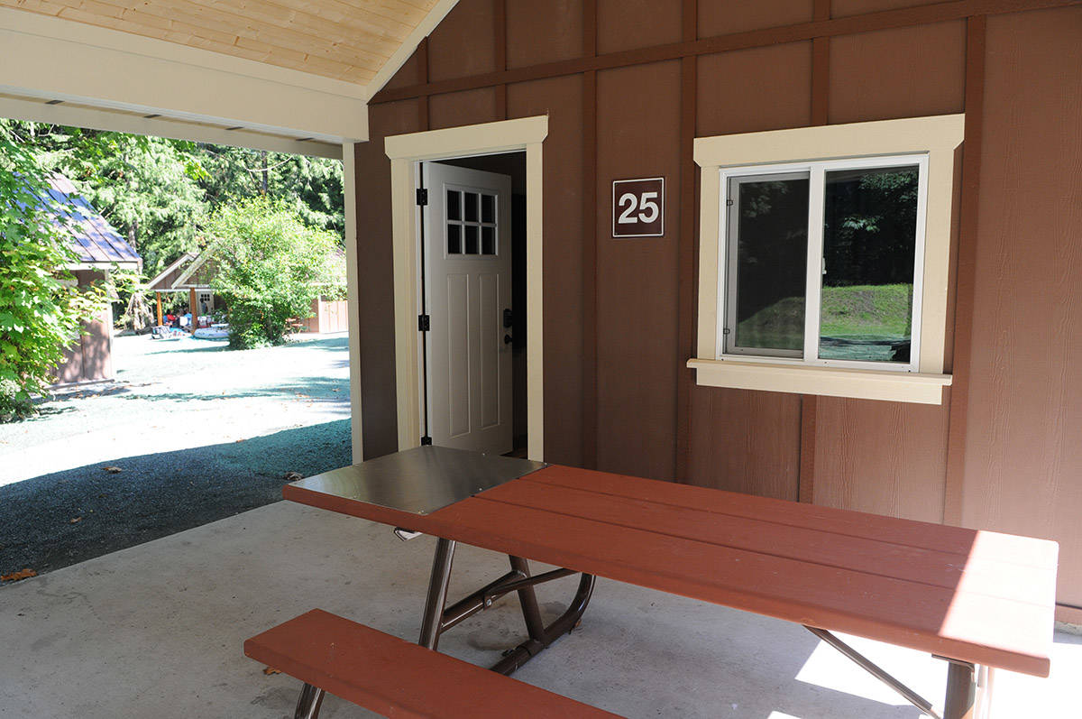 Each cabin features a picnic table with a stainless-steel cooking surface. (Jenna Hauck/ The Progress)