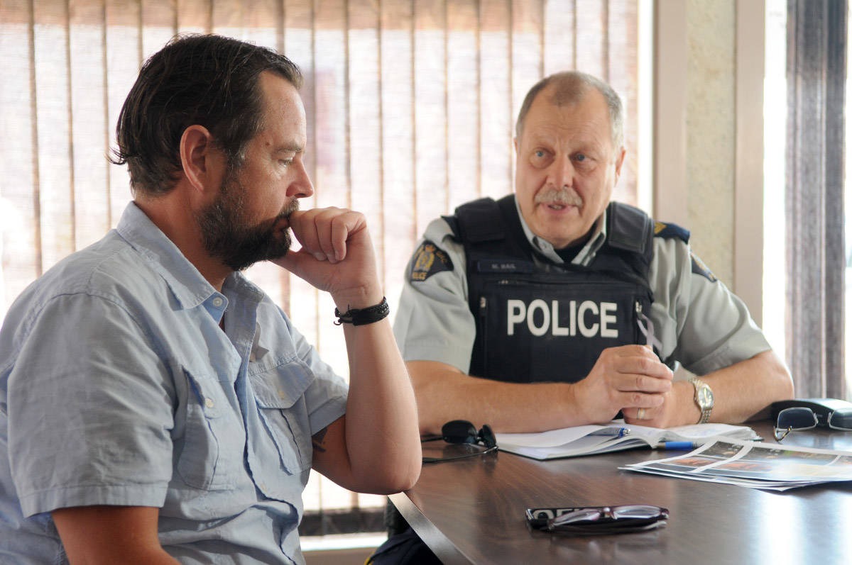Cpl. Mike Rail speaks with Dick Richards, the nephew of 86-year-old Grace Baranyk who went missing in Chilliwack on July 13. (Jenna Hauck/ The Progress)
