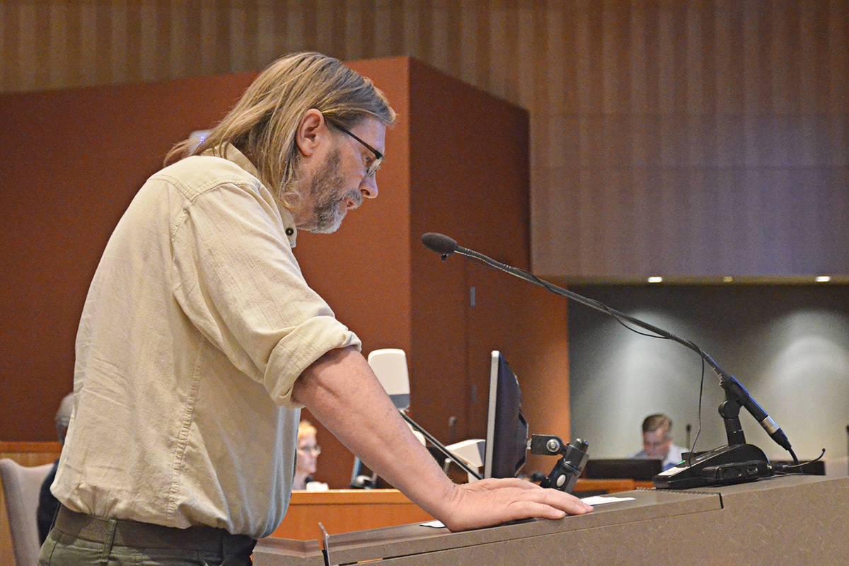George Otty was the first of more than 40 people to speak on the proposed demolition of almost a dozen buildings in Fort Langley. (Matthew Claxton/Langley Advance)