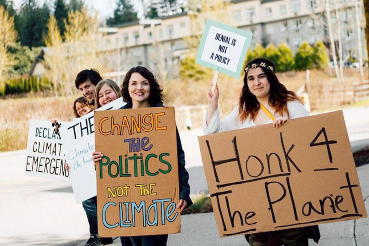 Cheryl Wiens, center, at one of the regular protests outside of the Township Civic Facility in the months before the vote on a climate emergency. (Tosha Lobsinger photo)
