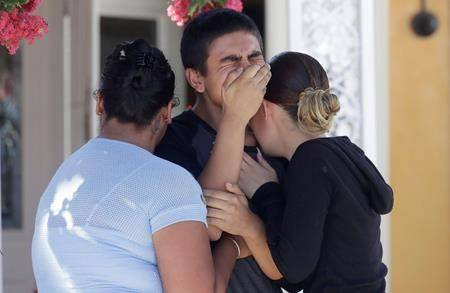 A town known for garlic grapples with grief after shooting