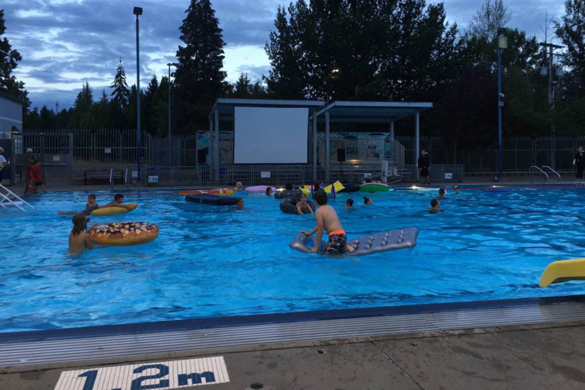 Swimmers braved the cloudy weather to watch Jaws in Al Anderson Memorial Pool for their Dive-In movie night last summer. (Langley Advance Times Files)
