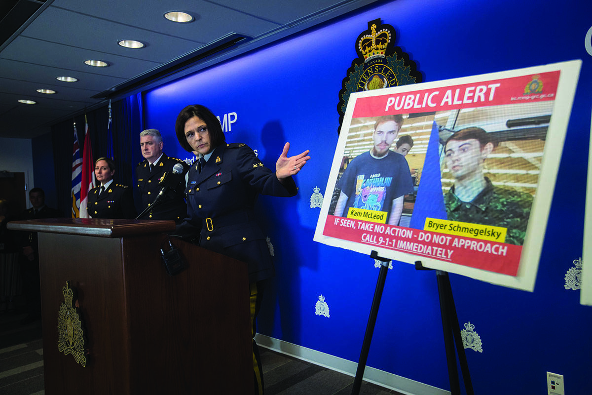 Security camera images recorded in Saskatchewan of Kam McLeod, 19, and Bryer Schmegelsky, 18, are displayed as RCMP Sgt. Janelle Shoihet speaks during a news conference in Surrey, B.C., on Tuesday July 23, 2019. THE CANADIAN PRESS/Darryl Dyck