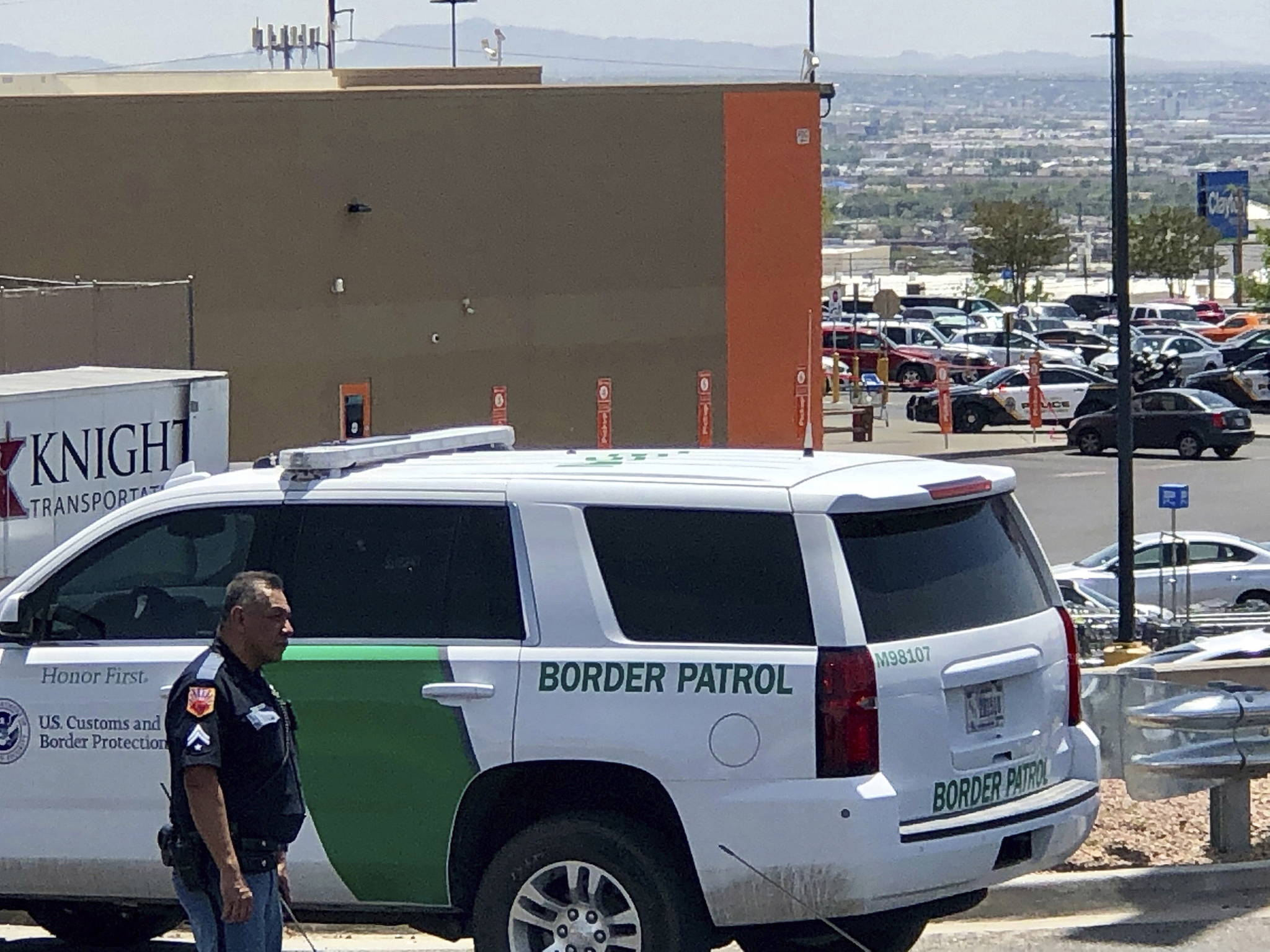 Law enforcement work the scene of a shooting at a shopping mall in El Paso, Texas, on Saturday, Aug. 3, 2019. Twenty people were killed and one person was in custody after a shooter went on a rampage at a shopping mall, police in the Texas border town of El Paso said. (AP Photo/Rudy Gutierrez)