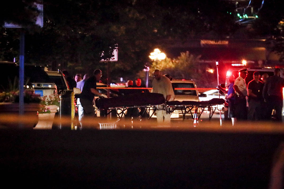 Bodies are removed from at the scene of a mass shooting, Sunday, Aug. 4, 2019, in Dayton, Ohio. Several people in Ohio have been killed in the second mass shooting in the U.S. in less than 24 hours, and the suspected shooter is also deceased, police said. (AP Photo/John Minchillo)