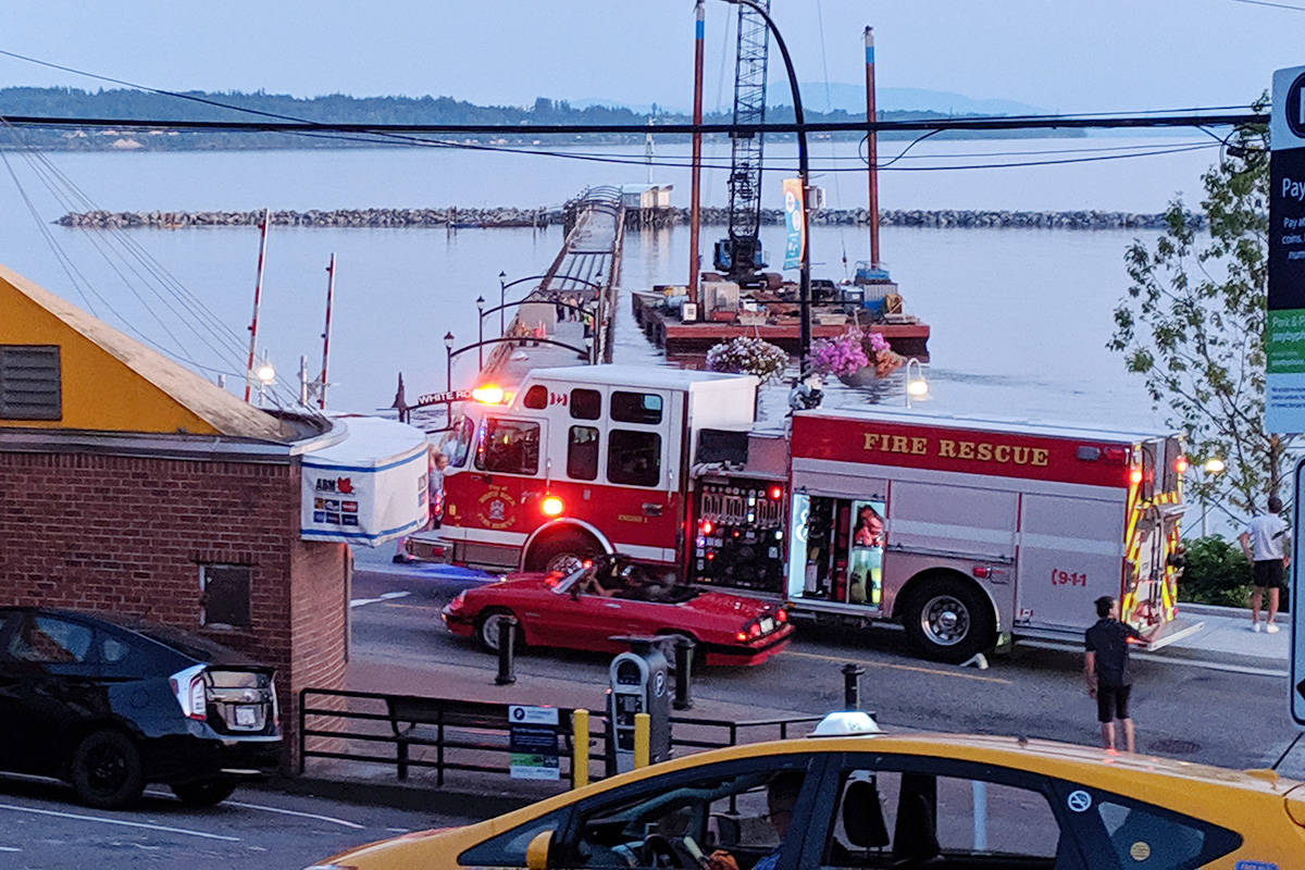 White Rock Fire Department, B.C. Emergency Health Services and the RCMP assisted with rescuing a couple teens off the White Rock Pier Tuesday evening.