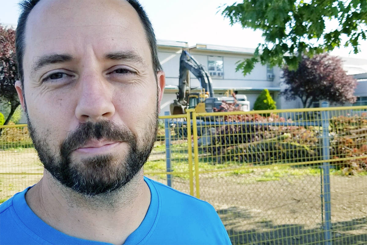 """Teacher Aaron Rowe said it was """"kind of an end to an era"""" to see the old wing come down. (Dan Ferguson/Langley Advance Times)"""