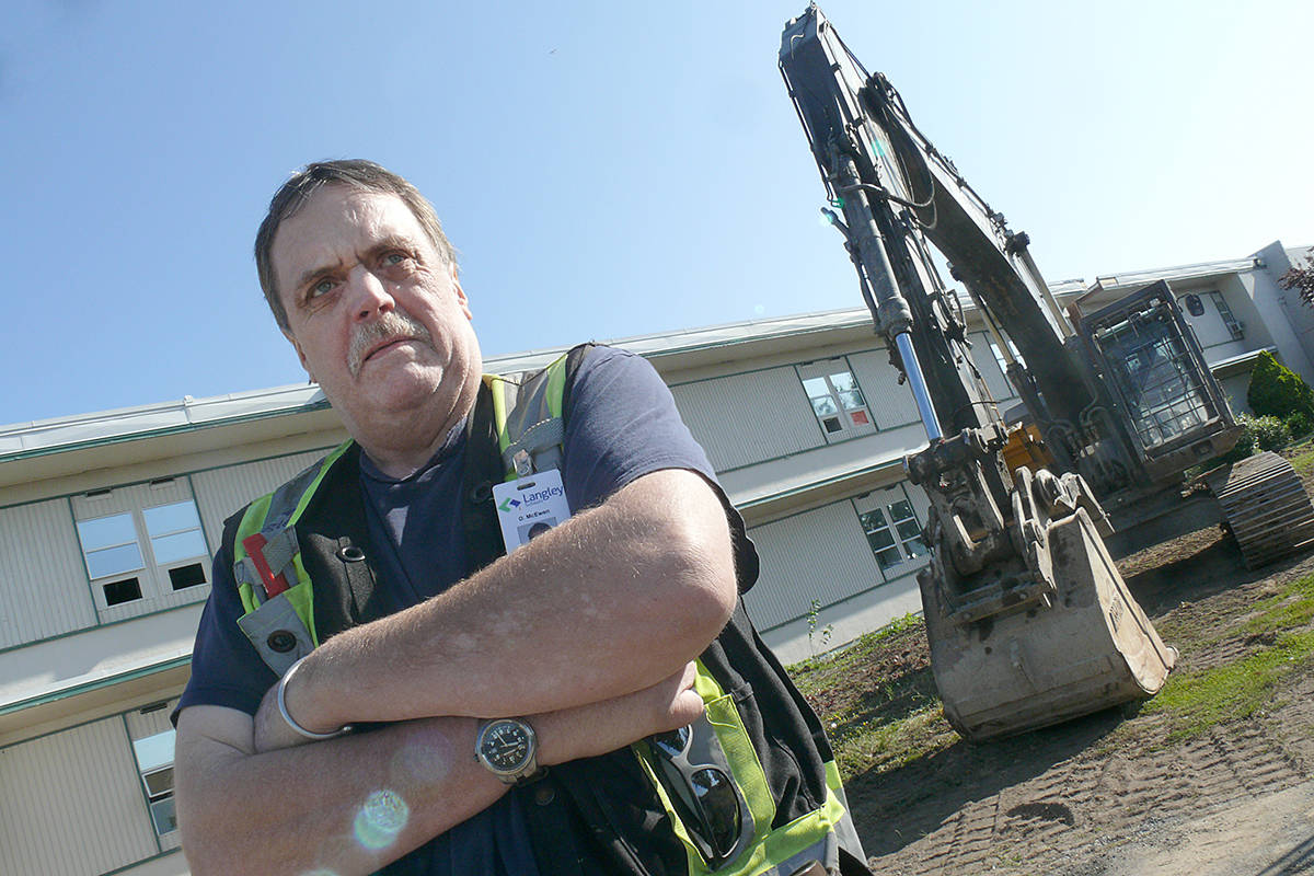 """Daryl McEwen said his time at Langley Secondary School was the """"best 10 years of my life."""" Now a plumber employed by the school district, the 77-78 grad dropped by to see the demolition of the oldest section of the school get underway. (Dan Ferguson/Langley Advance Times)"""