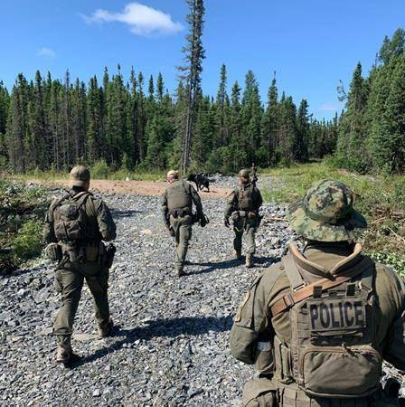 RCMP search an area near Gillam, Man. in this photo posted to their Twitter page on Tuesday, July 30, 2019. THE CANADIAN PRESS/HO, Twitter, Manitoba RCMP