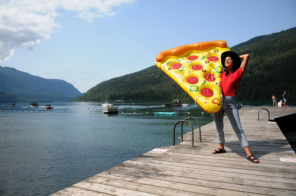 Danielle McTaggart started to float on Cultus Lake for 12 hours on this giant slice of pizza to on August 8 help raise money to send girls to school in Sierra Leone. The Cultus Lake Park Board has threatened to fine her for doing so without permits in violation of bylaws. (Jenna Hauck/ The Progress)