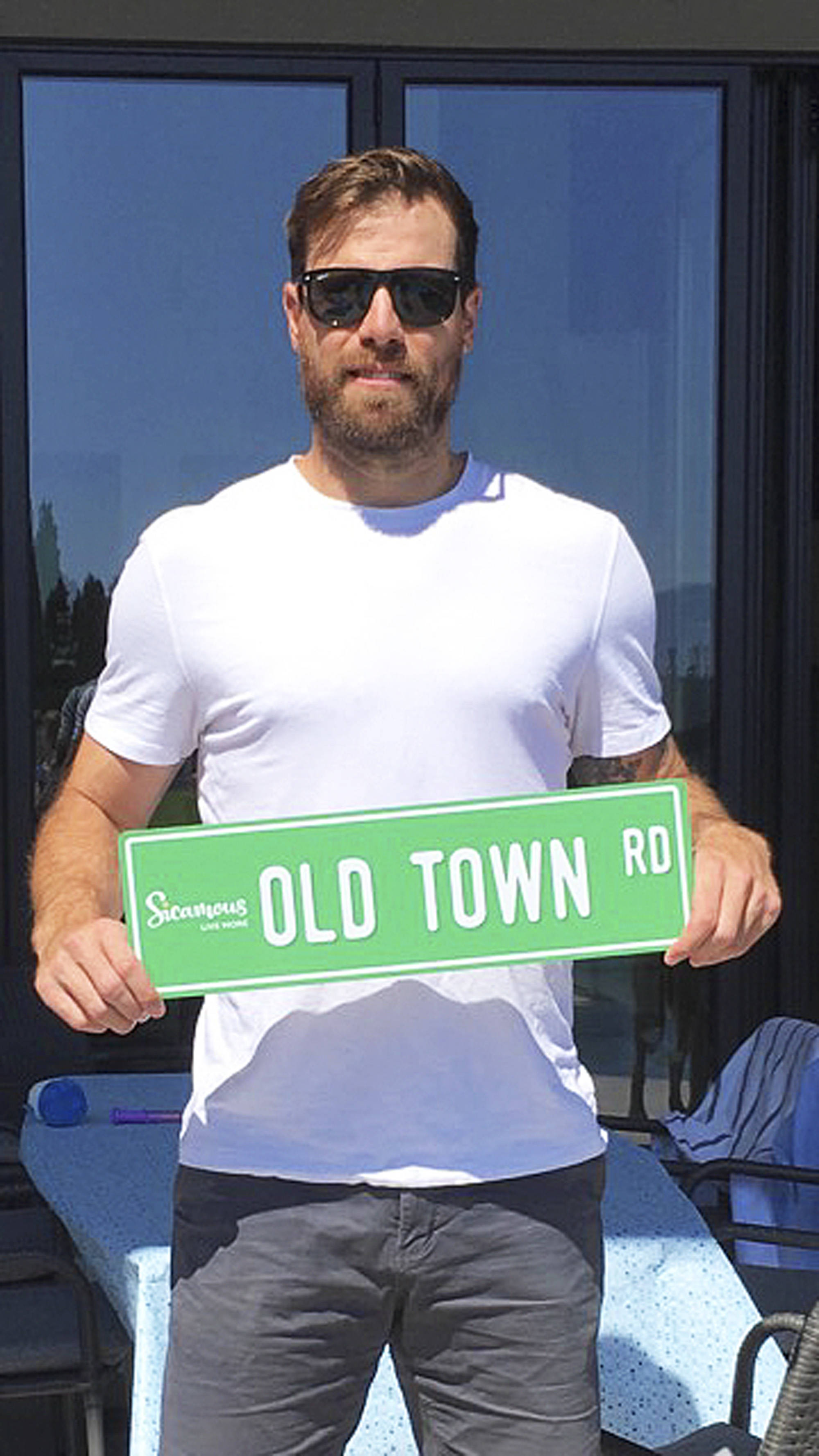 Sicamous native and NHL star Shea Weber received a new wall hanging from the district – one of the novelty Old Town Road signs being sold by the Sicamous and District Chamber of Commerce. (Photo submitted)