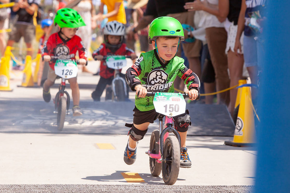 """Young racers push their """"balance bikes"""" during a Strider Cup event. (submitted photo)"""