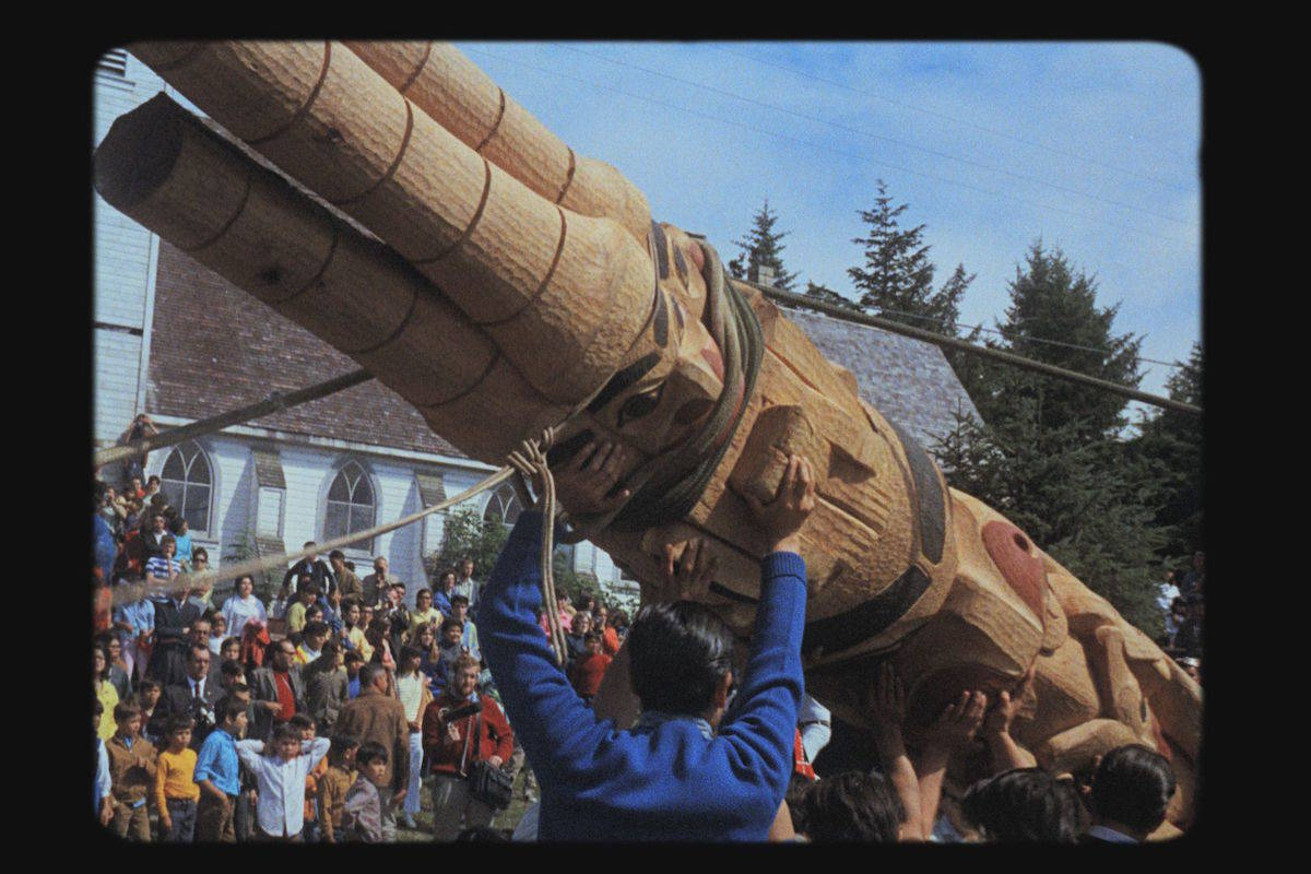 The first totem pole raising in almost a century took place in Old Massett in August 1969. (NFB photo)