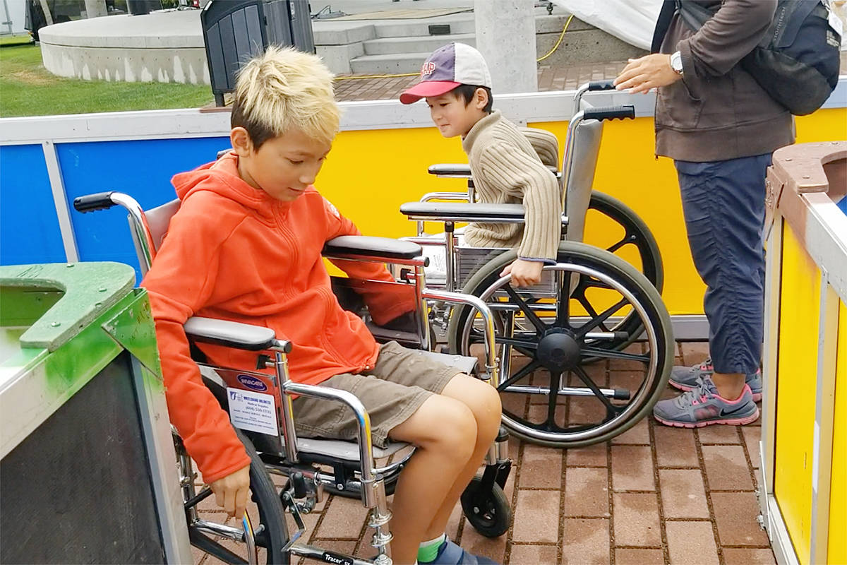 Brothers Soren and Nebi try to get by each other in the wheelchair maze. (Dan Ferguson/Langley Advance Times)