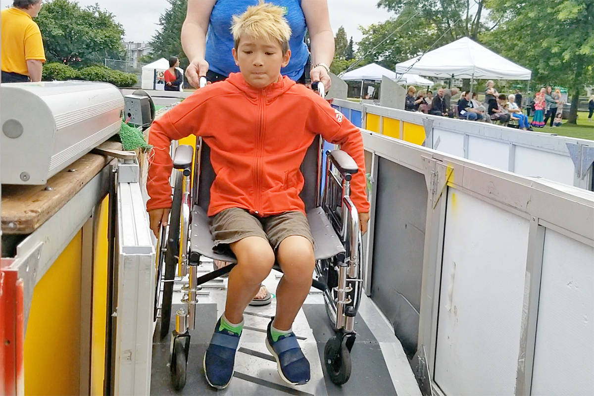 Soren, a Langley City resident, strained to complete the wheelchair maze at Day Of Pos-Abilities on Saturday in Langley City's Douglas Park. (Dan Ferguson/Langley Advance Times)