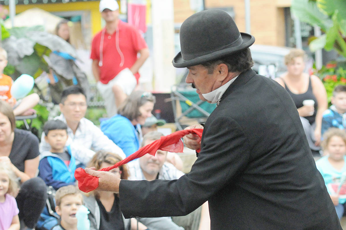 Magician Paul Romhany turned himself into the 'little tramp' character created by legendary silent film star Charlie Chaplin during a day devoted to magic at McBurney Plaza. (Dan Ferguson/Langley Advance Times)