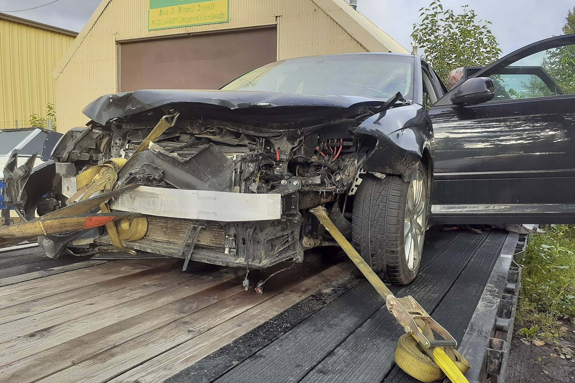 An Audi belonging to Jerry Petkau of Salmon Arm is a total write-off after an encounter with a black bear in eastern B.C. on Aug. 6. Petkau was not injured but the bear was killed. (Contributed)