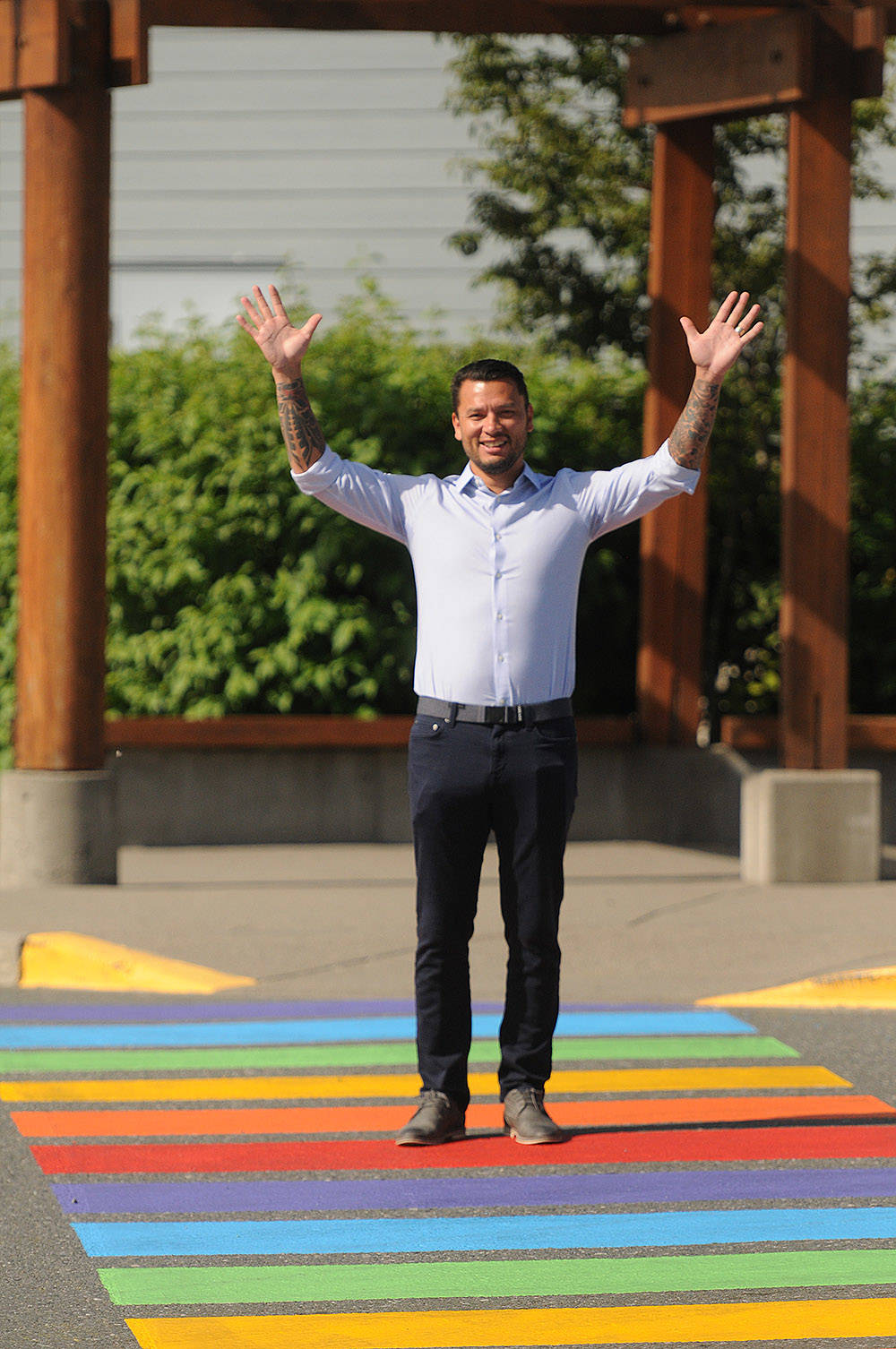 Squiala Chief David Jimmie stands in one of two freshly painted rainbow crosswalks at Eagle Landing shopping centre in Chilliwack on Tuesday morning. (Jenna Hauck/ The Progress)