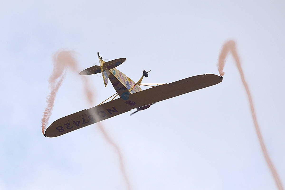 """Pilot Kent Pietsch performs some upside-down aerobatics with his 1942 """"Jelly Belly"""" Interstate Cadet plane. Pietsch has performed more than 400 aerobatic shows since 1973. (Patrick Penner photo.)"""