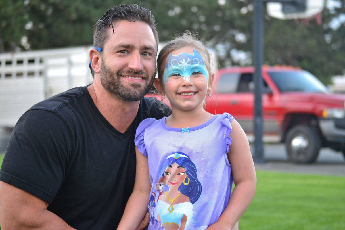 Aldergrove parents brought their children to the free movie in the park, hosted by ABA president Jodi Steeves, where they enjoyed popcorn, entertainment and a screening of an old classic The Neverending Story. (Sarah Grochowski photo).