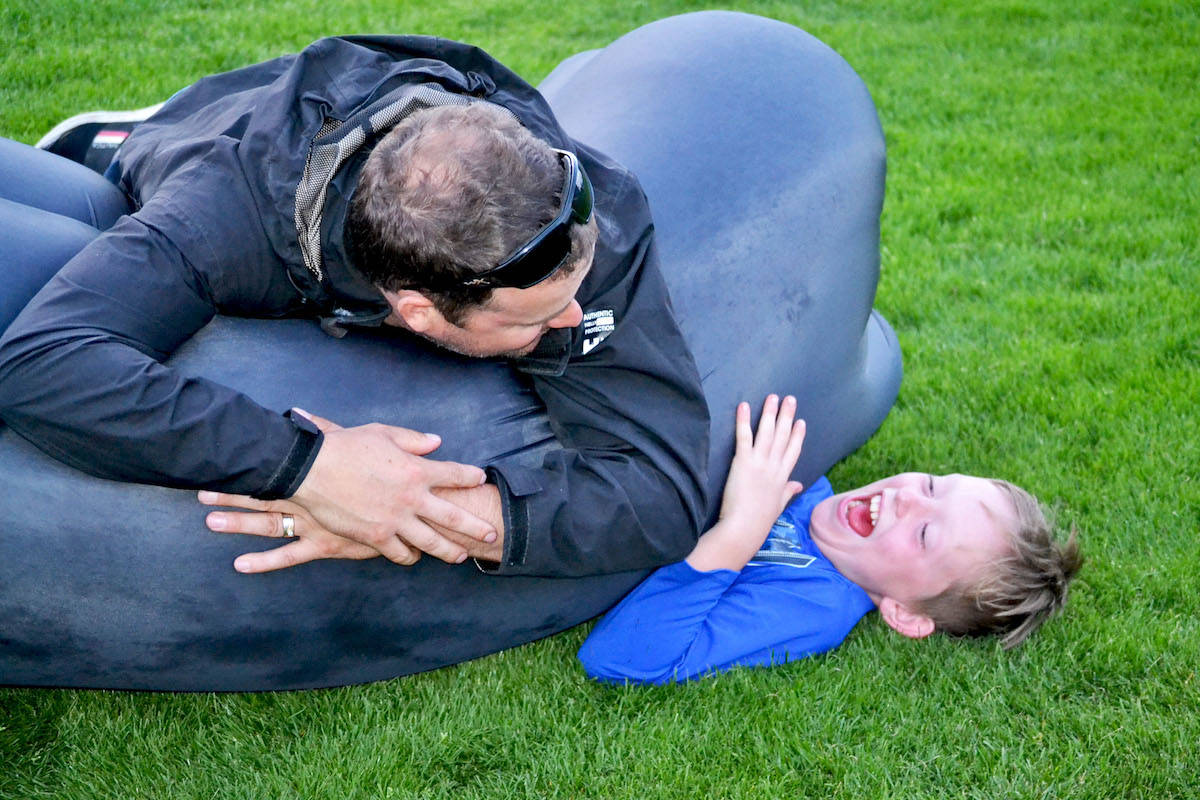 Steeves' husband Scott Byce, and nine-year-old son Jordan (below) played with their inflatable couch before the screening. (Sarah Grochowski photo)