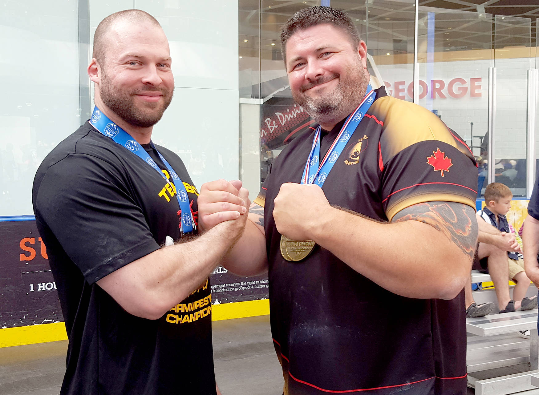 Chilliwack's Justin Hancock (left) with big-armed beast Ryan Espey from Manitoba, who won the 110 kilogram weight class in both arms. (Submitted photo)