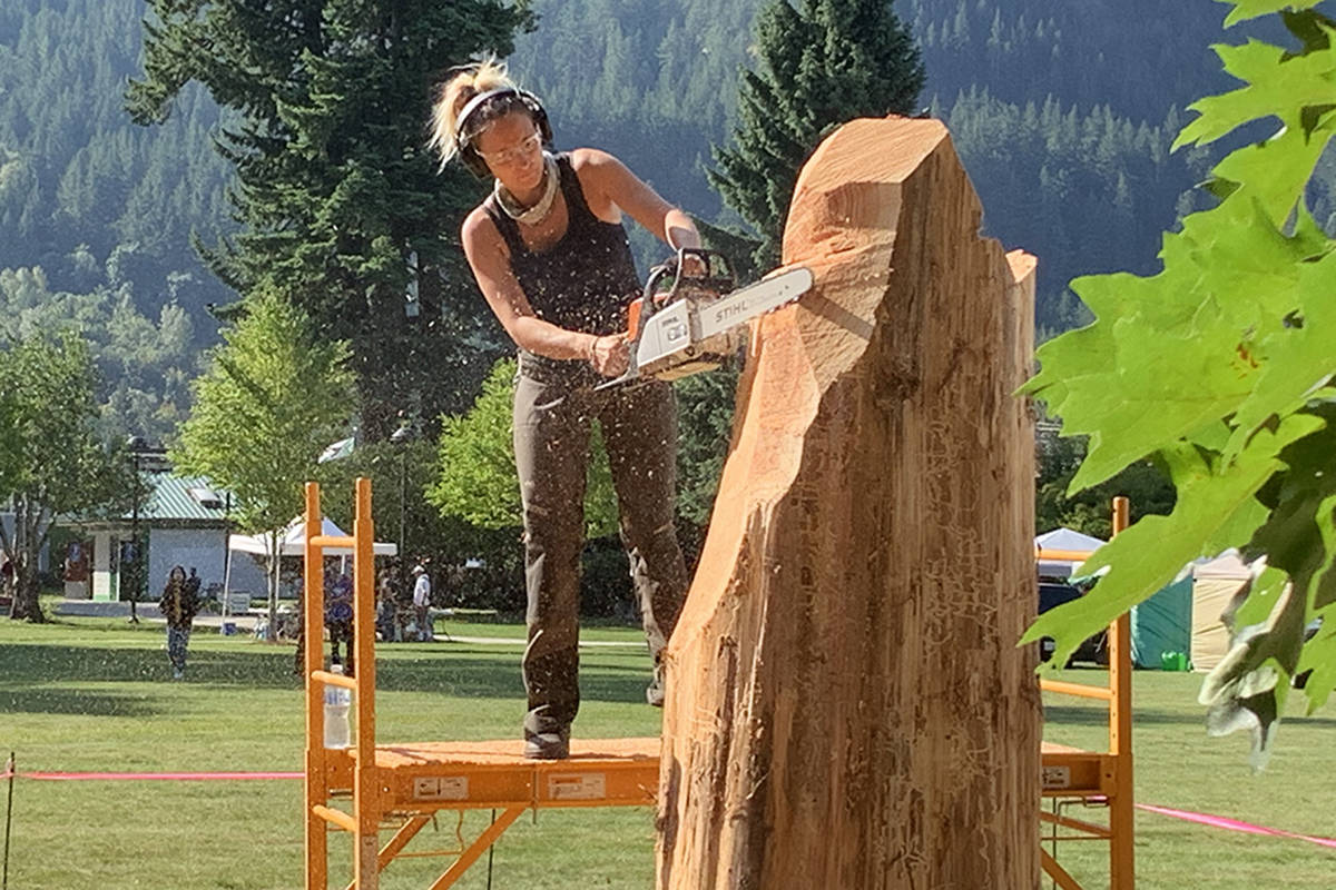 Marina Cole begins to give shape to her piece at the outset of the 2019 Chainsaw Carving Competition in Hope Memorial Park on Thursday morning. (Jessica Peters/ Black Press)