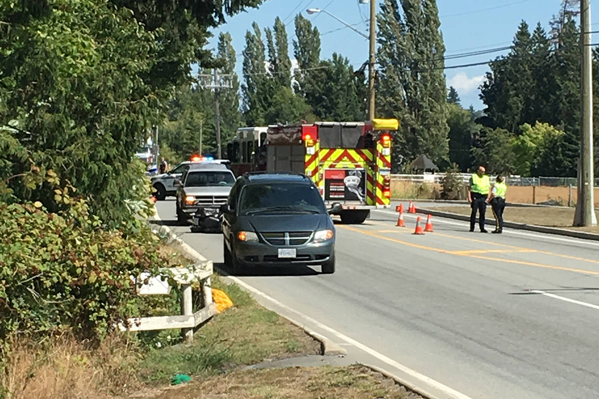 Police and fire crews attend the scene of a crash involving a motorcycle on 16 Avenue near 184 Steet. (Genia Camplin photo)